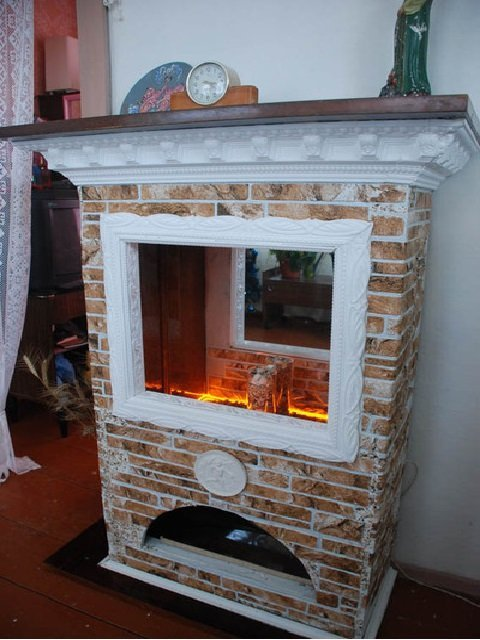 False fireplace from old furniture