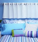 Занавеска в изголовьи кровати