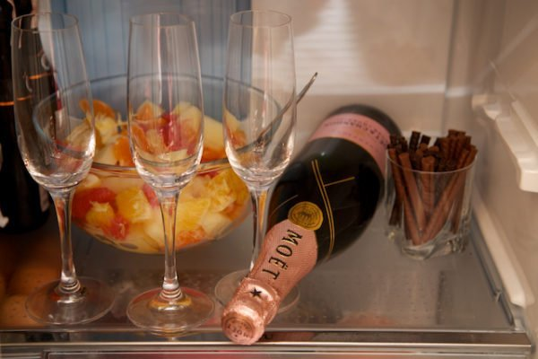 cooling champagne in the fridge