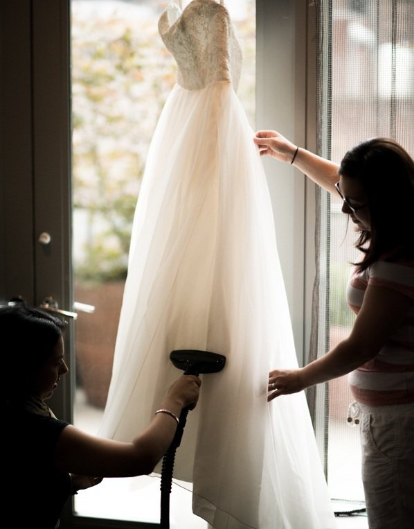 Cleaning the wedding dress with a steam generator