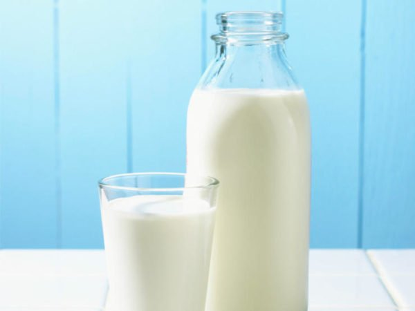 Bottle and a glass with a dairy product