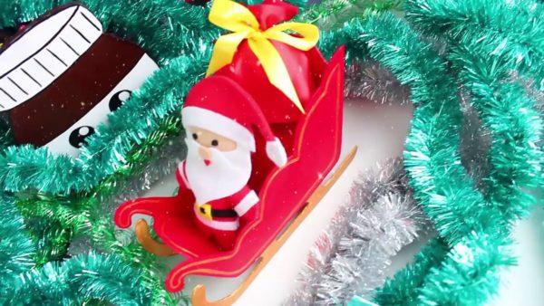 Игрушка Дед Мороз в санях с подарками
