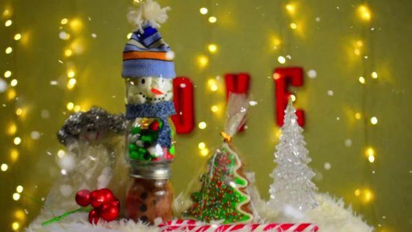 Новогодний снеговик из баночек с конфетами