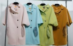 Four identical coats of pink, blue, olive and mustard