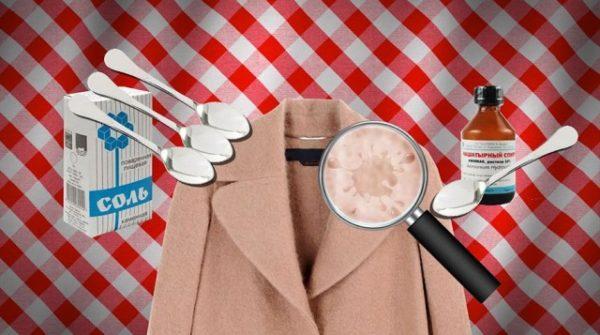 Пачка соли, флакон нашатыря, четыре ложки, лупа и бежевое пальто на фоне в клетку