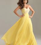 Жёлтое платье с широкой плиссированной юбкой