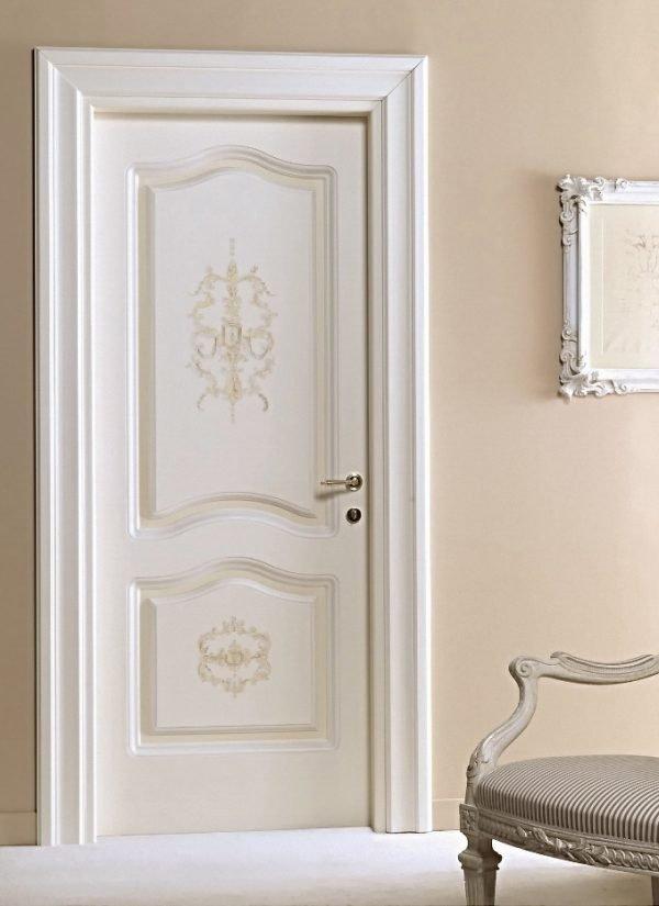 Белые межкомнатные двери с арочными филёнками