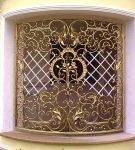 Кованые двери с золотым напылением