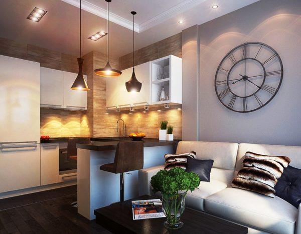 Зонирование кухни-гостиной с помощью светильников