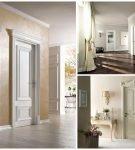 Белые классические двери на фоне светлых стен