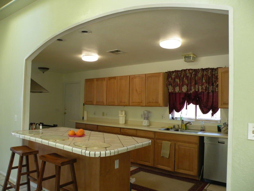 Фото арок на кухне с барной