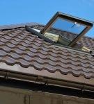 «Уникма» на крыше с окном