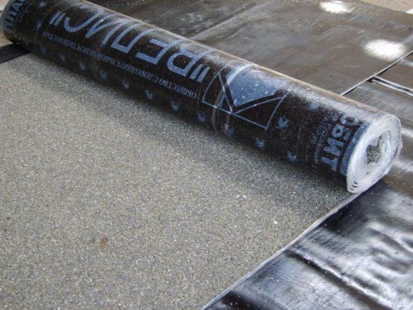 Покрытие плоской крыши рулонным материалом