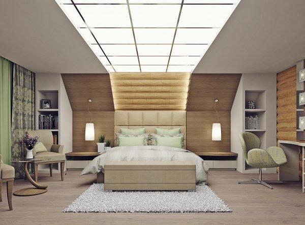 Дизайн спальни с большой кроватью в мансарде