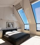 Чёрно-белая спальня в мансарде
