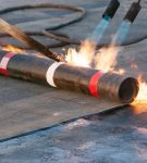 Процесс наплавления газовой горелкой