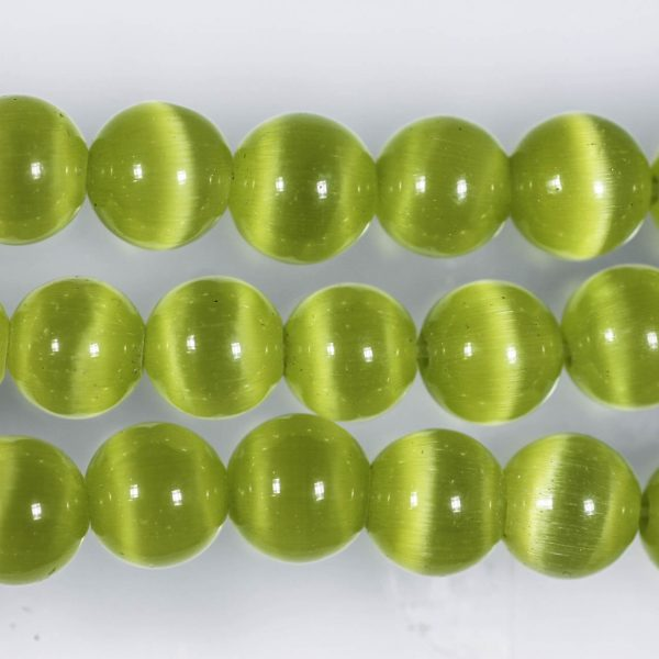 Бусины зелёного «Кошачьего глаза»
