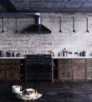 Большая кухня с тёмной мебелью в стиле лофт