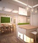 Белый холодильник на кухне с оформлением эко