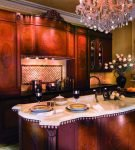 Тёмная мебель в стиле барокко для кухни