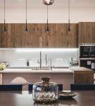 Мебель цвета натуральной древесины в обстановке кухни минимализм