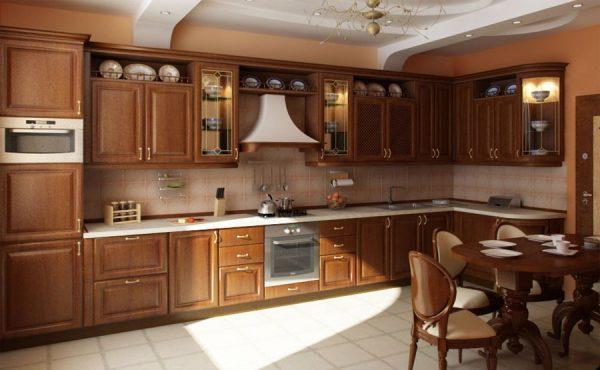 Красивый интерьер кухни с коричневой мебелью