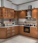 Холодильник в коричневой кухне, спрятанный в шкаф
