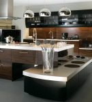 Большая кухня-гостиная в стиле хай-тек и оригинальной мебелью