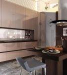 Контрастное оформление кухни с мебелью цвета капучино