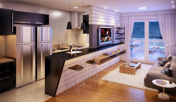 Просторная кухня-гостиная с диваном и яркими подушками