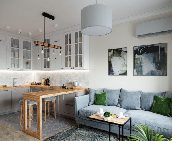 Светлая кухня-гостиная в скандинавском стиле с подсветкой гарнитура