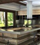 Современная кухня с большим столом-островом в загородном доме