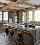Каменная столешница в дизайне кухни в стиле шале