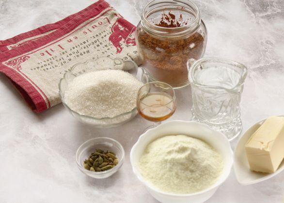 Продукты для приготовления домашних конфет из сухого молока и какао на столе
