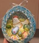 Курочка и яйца в корзине