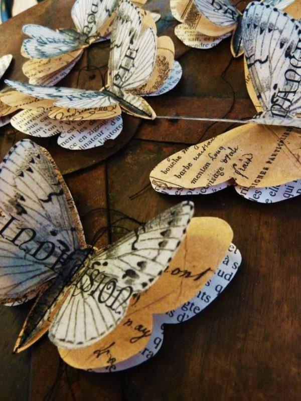 Комбинированные бабочки из газет и журналов